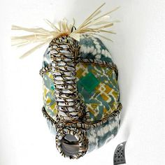 Shop our collection of beautiful textile African masks, handmade from upcycled containers and embellished with an assortment of local fabrics and other media by local artisans in Hout Bay, South Africa. Blue Orange, Red And Blue, Patchwork Fabric, African Masks, African Fabric, Printing On Fabric, Hand Sewing, Fashion Backpack, Captain Hat