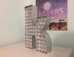 "11″ The Killers ""K"" marquee replica light."