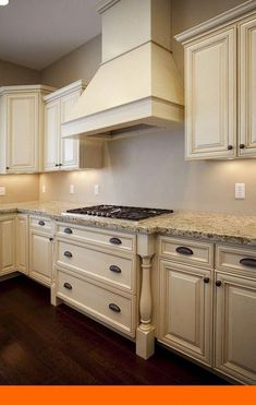 paint for kitchen cabinet the antiqued cabinets and light countertop 24269