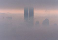 The twin towers of the World Trade Center are seen through fog from the observation deck of the Empire State Building in New York in 1996. (Marilynn K. Yee / The New York Times)