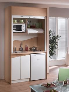 tiny kitchenette. perfect for a basement. mini fridge, stove, sink, and microwave. maybe have an island on wheels for added counter space