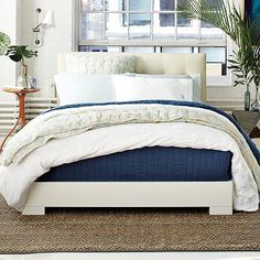 Chunky Wood Bed Frame - but DIY it here: http://ana-white.com/2010/06/plans/much-more-chunky-leg-bed-frame