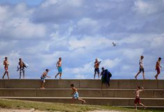 Children play along 12th Street Beach in Chicago on August 13, 2013. Lifeguards had told them to get out of Lake Michigan, because of rip tides and high levels of e. coli.