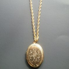 Locket necklace!!! NWOT! Beautiful locket, brand new, never used, holds 2 pictures inside, gold plated, long beautiful chain!!! Jewelry Necklaces