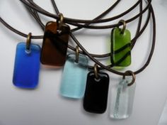 Beca Designs- recycled glass jewelry. Brown leather slip knot necklaces with recycled glass pendant. $20 By Beth Carter