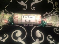 "Pamper your piggies with a ""Footsie Roll"" set includes an invigorating Mint Bliss Lotion for tired feet. $10"