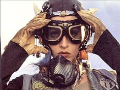 Goggles and fishnet respirator masks are key <-- ha ha, I need to re-watch this gem, Tank Girl Lori Petty, Steampunk, Red To Blonde, Glamour, Tank Girl, Dieselpunk, Festival Outfits, Red Hair, Actors & Actresses
