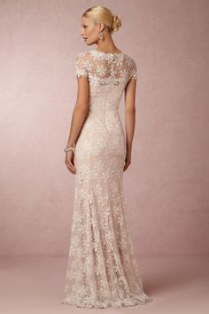 Enjoy our top 15 Lace Back Wedding Dresses & Gowns, filled to the brim with delicate detail and gorgeous glamour. Yum!