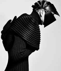 futuristic avant garde couture armadillo-esqu plated leather headpiece with chunky weave jumper featuring an oversized collar - photographed by Yasunari Kikuma - pinned by RokStarroad.com