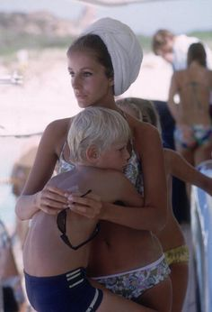 Recent widow Dolores Guinness with son Patrick on a yacht in Sardinia. Photo: Slim Aarons, 1966.