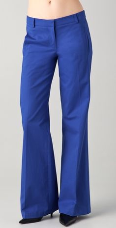 These textured cotton wide-leg trousers feature welt front pockets and flap back pockets. Double hook-and-eye closure.