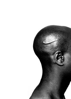 - Branded Head, Hank Willis Thomas, 2003 - I think this photograph represents the branding of African-American athletes. Nike is one of the largest athletic brands in the world and this picture signifies how it is represented. Hank Willis Thomas appears to have intentionally cut off the face of the man to show how large brands have taken away the personalities of black athletes and simply printed the logo of their company as who they are.