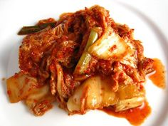 Kimchi; I'm making lots of this now with my excess garden radishes, the outer cabbage leaves, and red onion tops.