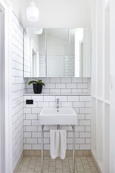 neon mizzle: INTERIOR CRUSH: white on white! -- Shelf ledge behind sink solves issue of limited counter space when a pedestal sink is used. Mirrored cabinet and wall alcoves provide added storage.  I'm still not sure if I'm a fan of dark grout with white tile . . .
