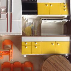 Vintage 1970s Dollhouse furniture by Tomy Smaller Home and Garden collection. Made in Japan. This set comes with a refrigerator/freezer, sink, dishwasher, dining table with 4 chairs, napkins, placemats, plates, glasses, forks, knives and spoons. The set is in very good condition, the