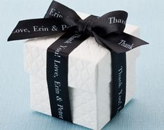 Beautiful Personalized Ribbons in black satin on a white quilted box makes a great wedding or party favor