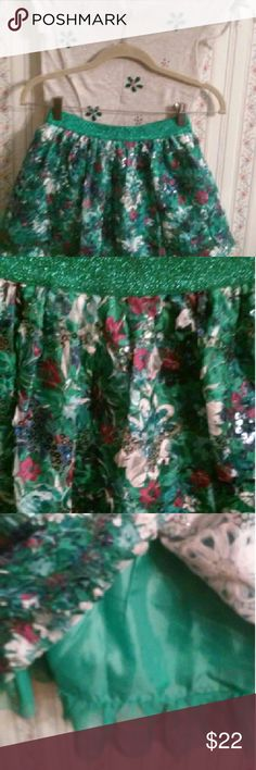 Justice Fancy Skirt Adorable,   skirt has built in shorts & tulle   Worn once,  Sparkly and fun! teals, white, purple & maroon.  Sparkle embellishments over skirt.  Purchase skirt and matching top for $19. Justice Matching Sets