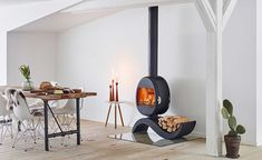 An S-shaped woodburning stove from Scan