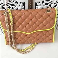 """Rebecca Minkoff Studded Quilted Affair Bag Tan Gently used only flaw is there are some small marks in a few spots on the neon trim. Mostly right on the front flap. And an odd crease in the leather on the front. Tan with neon trim studded are gold. Strap can be wore doubled or single. Strap drop about 20"""" to 23"""" not adjustable. Snap closure back snap pocket inside zippered pocket and two slip pockets. Comes with dust bag. About 11"""" x 8"""" x 2"""". Rebecca Minkoff Bags Shoulder Bags"""