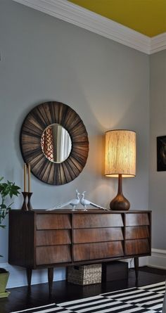 32 Original Mid-Century Sideboards You Gonna Love | DigsDigs (this pic: balance of decor...on our chest: lamp, candlesticks, starburst clock, and ??)