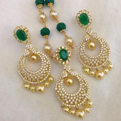 CZ and Emerald pendant with pearl drops and earrings Code : PS 392 Price: Rps. 1850/- Whatsap to 09581193795 for order processing