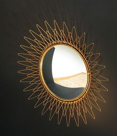 Brass sun mirror Pilastro 1950 eames era | 20th century Modern online gallery. Featuring a large and varied selection of vintage design and architect furniture. | Shipping worldwide | http://www.furniture-love.com/vintage/objects/