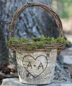 Customize a rustic birch basket ($48) with the names or initials of the bride and groom — an unexpected, sweet touch.