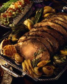 Rosemary Rib Roast  An impressive centerpiece dish. This looks beautiful when surrounded with sautéed baby vegetables. Start marinating the meat one day ahead. Serve homemade or purchased horseradish alongside.