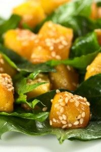 Butternut, Spinach, and Pumpkin or Sesame Salad -  Ingredients:  1 butternut squash, approximately 2 1/4 pounds;  1 teaspoon celtic sea salt;  1 teaspoon ground turmeric;  1 teaspoon ground ginger;  2 tablespoons extra virgin olive oil for squash, plus 2 tablespoons for dressing;  1/3 cup golden raisins;  1/4 cup water, boiled;  1 teaspoon sherry vinegar;  4 ounces (about 3 cups) spinach and other salad leaves if desired;  1/3 cup pumpkin seeds, toasted or sesame seeds toasted.