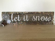 """Rustic, barn wood """"Let it Snow"""" sign."""