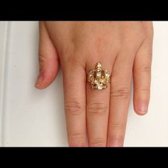 Gold crown costume ring Adjustable from size 6 half and up. Has all rhinestones very nice in person. Warn once. Jewelry Rings