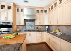 Maple kitchen with upper display cabinets - so much nicer than soffits