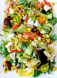 Summer salad with fresh vegetables, goat cheese, hazelnuts, and a light vinaigrette