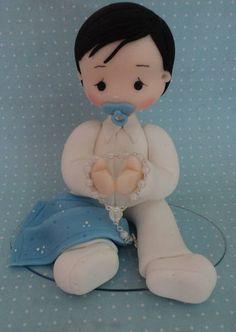 boneco em biscuit co 13 cm para topo de batizado. contato:arteira_2010@hotmail.com