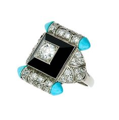 An art deco diamond, onyx, turquoise and platinum ring.