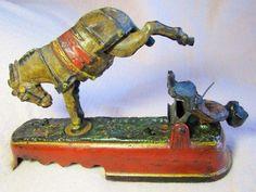 Die-cast kicking mule mechanical bank, 1897