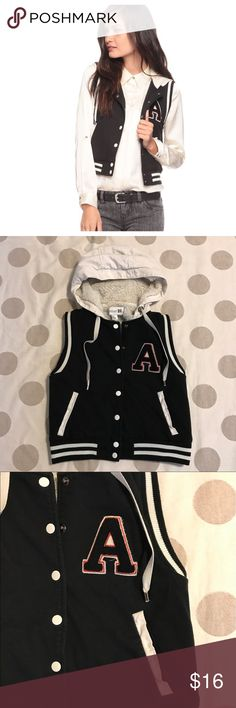 Forever 21 black varsity vest You're looking at a preloved Forever 21 vest in size small. Black varsity letterman style with cream hood. Letter A is black with cream & red accents. Lined with soft cream fuzzy. Snaps closed. Has functional front pockets. Adorable!  Fitted style. 💙offers 💙20% off discount on bundles 🚫PayPal/trades Forever 21 Jackets & Coats Vests