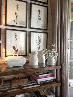 botanical prints and simple white accessories with rustic shelves