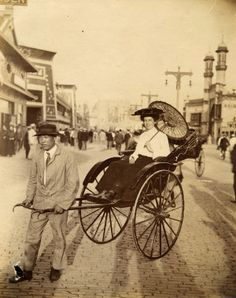 Woman in a rickshaw on the Pike at the 1904 World's Fair.