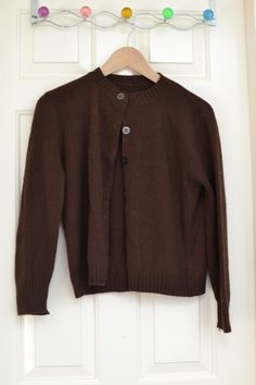 """Vintage brown cardigan, likely hand knit acrylic. Measures approx 20"""" armpit to armpit. A bit pilly but no pulls I can find."""