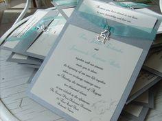 beautiful silver and aqua handmade wedding invitations with double heart charm from www.rubiesandpearlsllc.com/rubyspearlsprinting.html