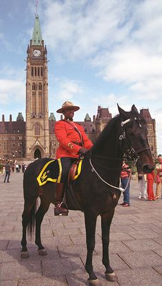 Mountie Man  -  Mounties, or Royal Canadian Mounted Police, are the primary national police force in Canada, and  he  is in his ceremonial dress uniform. The background is the Peace Tower on the Parliament buildings, the seat of federal government.