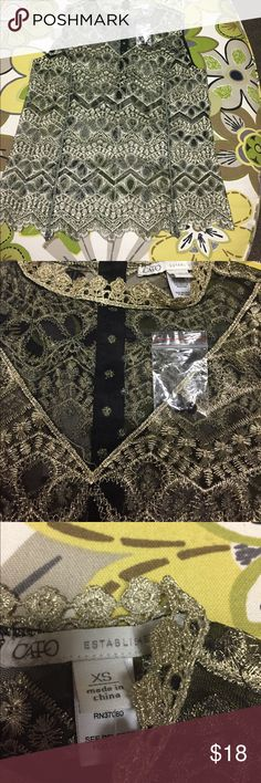 Cato gold lame and black top Size XS Beautiful gold lace like top with black sheer fabric accents. Shirt button up 1/2 of back to neckline. Measures 17 inches across bust and is 23 inches long Cato Tops Tank Tops