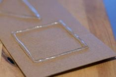 Hot glue rubbing plates.