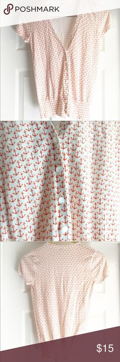 J. Crew Red & White Anchor Cardigan This cardigan is so fun and perfect for the 4th of July! (Or any event, really!) Its a white background with a bright red anchor pattern! Short sleeves makes this a perfect piece to throw on over a tank in the warmer months! Pearly looking buttons, and there's even an extra button attached near the care tag. EUC aside from a tiny hold right by the top shoulder seam that can't really be seen unless you're pulling at it. J. Crew Sweaters Cardigans