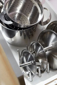 Stack pans and lids separately to make the most of space