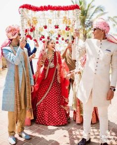 Songs for bridal entry - Indian wedding - bride entering under phoolon ki chaadar with red roses and kaleerey hanging wedding photography 30 Best Bridal Entry Songs - The Ultimate List (English, Hindi, Bollywood, Covers, Everything! Indian Wedding Bride, Wedding Mandap, Desi Wedding, Indian Wedding Outfits, Wedding Music, Bridal Outfits, Indian Bridal, Wedding Bells, Wedding Ideas