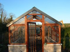 Timber frame Greenhouse with recycled windows-- i want my future husband to build me this