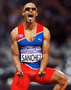 Dominican Republic's Felix Sanchez reacts after winning gold in the men's 400-meter hurdles final Monday, Aug. 6. Though he competes for the Dominican Republic, Sanchez is a US citizen and grew up in San Diego.