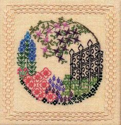 """Fantasy Garden takes on on a garden stroll through the world of blackwork. The design size is 12"""" x 12"""". Supplies required: 18"""" (6"""" included for finishing) Cream Dublin Linen (3604-222) DMC Floss: 517, 518, 911, 602, 913, 601, 553, 327, 209, 3012, 907, 3348, 309, 413 DMC Size 8 Pearl Cotton: 712 or Ecru 10 pages, spiral binding."""